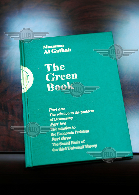 Colonel Muammar Al Gaddafi's Green Book, which features outlines of his democratic views and his political philosophy.