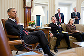 United States President Barack Obama is briefed in the Oval Office before meeting with a bipartisan group of Congressional leaders regarding Libya, March 18, 2011. Pictured, from left, are: Chairman of the Joint Chiefs of Staff Admiral Mike Mullen; Ben Rhodes, Deputy National Security Advisor for Strategic Communications; Secretary of State Hillary Rodham Clinton; and Bill Burns, Under Secretary of State for Political Affairs..Mandatory Credit: Pete Souza - White House via CNP