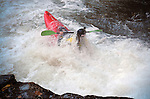 November 5, 2016 - Hendersonville, North Carolina.  A kayker comes up for air after completing the Scream Machine Rapids prior to the 21st annual Green Race.The Green River Narrows provides one of the most intense and extreme whitewater venues in the world and is home to many of the USA's most talented paddlers.  Green River Narrows, Hendersonville, North Carolina.