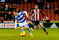 Queens Park Rangers midfielder Josh Scowen (11) turns inside Sheffield United's defender Danny Lafferty (24) during the Sky Bet Championship match between Sheff United and Queens Park Rangers at Bramall Lane, Sheffield, England on 20 February 2018. Photo by Stephen Buckley / PRiME Media Images.