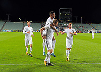 Chris Wood celebrates his hat trick with teammates Myer Bevan (left), James Musa (piggyback) and Deklan Wynne (right) during the first leg of FIFA World Cup Russia 2018 qualifying football match between the New Zealand All Whites and Solomon Islands at QBE Stadium in Albany, New Zealand on Friday, 1 September 2017. Photo: Dave Lintott / lintottphoto.co.nz