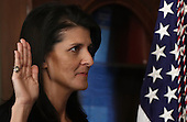 Nikki Haley raises her right hand while being sworn in as the U.S. Ambassador to the United Nations January 25, 2017 in Washington, DC. Haley was formerly the Governor of South Carolina. <br /> Credit: Win McNamee / Pool via CNP