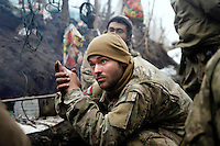 """UKRAINE, 02.2016, Oblast Donetsk. Ukrainian-Russian conflict concerning Eastern Ukraine / Foreign volunteers (""""Task Force Pluto"""") fighting with the far-right militia Pravyi Sektor against the Russian-backed separatists: Cowboy (USA) ducks while grenades are being fired at their trench positions at the Donetsk frontline. © Timo Vogt/EST&OST"""