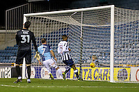 Garry Thompson of Wycombe Wanderers scores his second and Wycombe's third during the Checkatrade Trophy round two Southern Section match between Millwall and Wycombe Wanderers at The Den, London, England on the 7th December 2016. Photo by Liam McAvoy.
