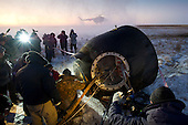Russian support personnel work to help get Expedition 29 crew members out of the Soyuz TMA-02M spacecraft shortly after the capsule landed with Expedition 29 Commander Mike Fossum, and Flight Engineers Sergei Volkov and Satoshi Furukawa in a remote area outside of the town of Arkalyk, Kazakhstan, on Tuesday, November 22, 2011. NASA Astronaut Fossum, Russian Cosmonaut Volkov and JAXA (Japan Aerospace Exploration Agency) Astronaut Furukawa are returning from more than five months onboard the International Space Station where they served as members of the Expedition 28 and 29 crews. .Mandatory Credit: Bill Ingalls / NASA via CNP