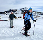 Matt Gay and Sarah Matson, of Boston, snowshoe to the Snodgrass area above Crested Butte, CO.  © Michael Brands.
