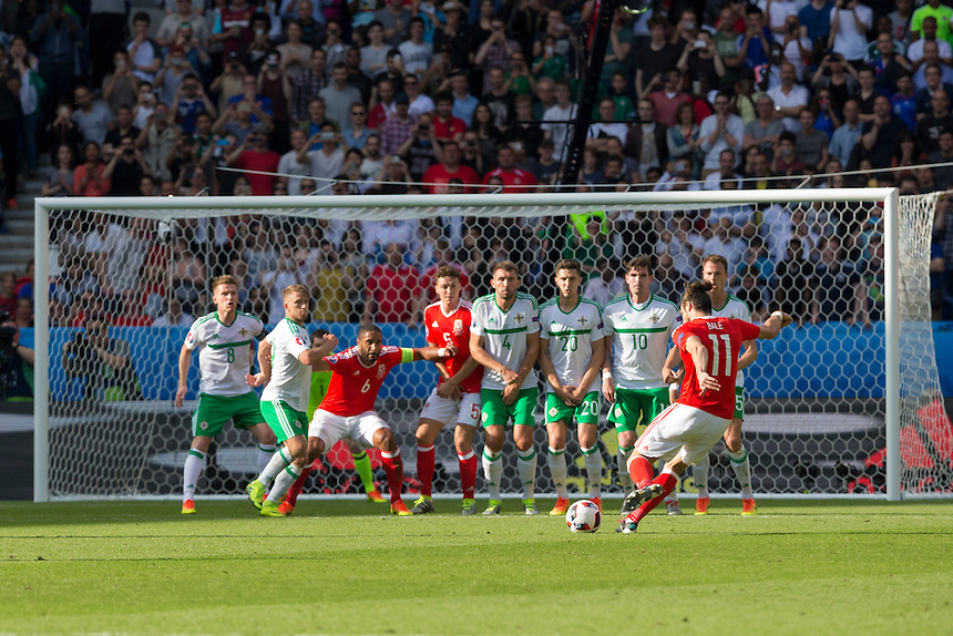 Wales's Gareth Bale takes a free kick<br /> <br /> Photographer Craig Mercer/CameraSport<br /> <br /> International Football - 2016 UEFA European Championship - Round of 16 - Wales v Northern Ireland - Saturday 25th June 2016 - Parc des Princes - Paris - France<br /> <br /> World Copyright &copy; 2016 CameraSport. All rights reserved. 43 Linden Ave. Countesthorpe. Leicester. England. LE8 5PG - Tel: +44 (0) 116 277 4147 - admin@camerasport.com - www.camerasport.com