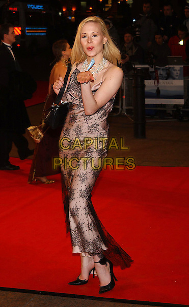 "ARIANNE SOMMER.""Cold Mountain"" film premiere.Odeon Leicester Square, London .14 December 2003.full length, full-length, lace dress, blowing kiss.sales@capitalpictures.com.www.capitalpictures.com.©Capital Pictures"