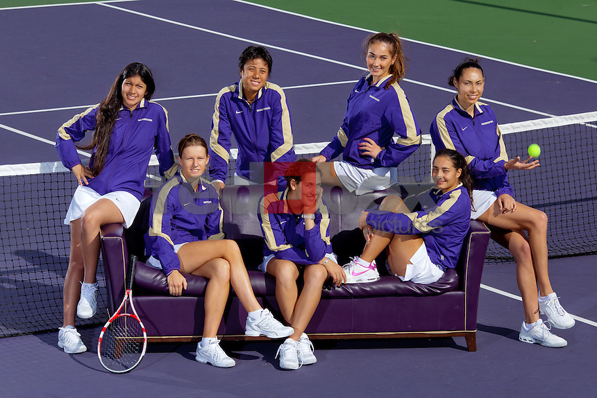Clockwise from left: Natali Coronel, Denise Dy, Adrijana Pavlovic, Samantha Smith, Andjela Nemcevic, Julija Lukac and Capucine Gregoire. -- The University of Washington Huskies women's tennis team poses at their outdoor courts in Seattle Wednesday, Oct. 12, 2011. (Photo by Andy Rogers/Red Box Pictures)