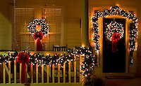 Christmas lights and decorations adorn a home in the town of McAdenville, NC. The town of McAdenville has been celebrating Christmas by decorating the homes in town with red, green and white lights and has come to be known as Christmas Town USA.