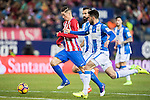 Fernando Torres (l) of Atletico de Madrid battles for the ball with Deportivo Leganes' players during their La Liga match between Atletico de Madrid and Deportivo Leganes at the Vicente Calderón Stadium on 04 February 2017 in Madrid, Spain. Photo by Diego Gonzalez Souto / Power Sport Images