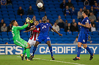 Sol Bamba of Cardiff City shields his goalkeeper Neil Etheridge from Leon Clarke of Sheffield United during the Sky Bet Championship match between Cardiff City and Sheffield United at Cardiff City Stadium, Cardiff, Wales on 15 August 2017. Photo by Mark  Hawkins / PRiME Media Images.