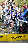 October 31, 2010:  Men's pro riders charge the run-up during the 2010 Boulder Cup Cyclocross Championship, Boulder, Colorado.