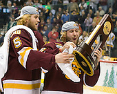 Trent Palm (Duluth - 5), Chad Huttel (Duluth - 26) - The University of Minnesota-Duluth Bulldogs celebrated their 2011 D1 National Championship win on Saturday, April 9, 2011, at the Xcel Energy Center in St. Paul, Minnesota.