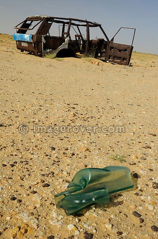 Africa, Mauritania, Sahara Desert. Melted screen glass aside the remains of a burnt out Range Rover Classic 4-door on a desert piste between Nouadhibou and Choum. --- No releases available. Automotive trademarks are the property of the trademark holder, authorization may be needed for some uses.