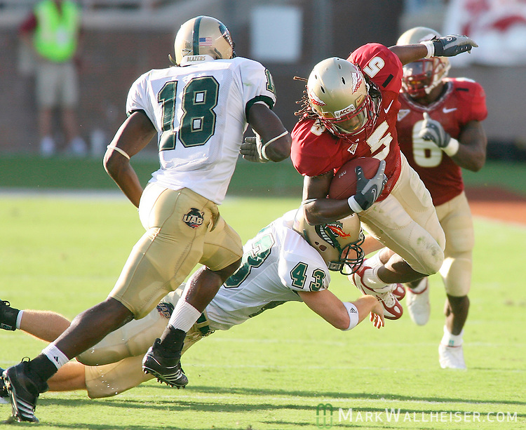 Seminole wide receiver Preston Parker gets tripped up by UAB's Matt Taylor in the 1st half of the FSU vs UAB football game at Doak Campbell Stadium September 8, 2007.    (Mark Wallheiser/TallahasseeStock.com)