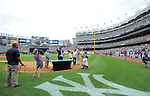Hideki Matsui,<br /> JULY 28, 2013 - MLB :<br /> Hideki Matsui waves to fans as New York Yankees general manager Brian Cashman, assistant general manager Jean Afterman and his family look on during his official retirement ceremony before the Major League Baseball game against the Tampa Bay Rays at Yankee Stadium in The Bronx, New York, United States. (Photo by AFLO)