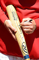 Philadelphia Phillies coach Wally Joyner autographs a bat before a Spring Training game against the Dominican Republic at Bright House Field on March 5, 2013 in Clearwater, Florida.  The Dominican defeated Philadelphia 15-2.  (Mike Janes/Four Seam Images)