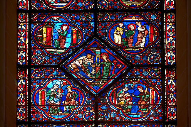Medieval stained glass Window of the Gothic Cathedral of Chartres, France - dedicated to the Life and Miracles of St Nicholas.  Bottom left panel - The young Nicholas refuses his mother's milk, bottom right panel - Nicholas studying in school . Centre diamon panel - Nicholas gives a poor man the money for his daughters' dowries. Top left -  Guided by God, Nicholas goes to the church early one morning, top right - A cleric asks Nicholas his name, then bids him to enter the church . A UNESCO World Heritage Site.