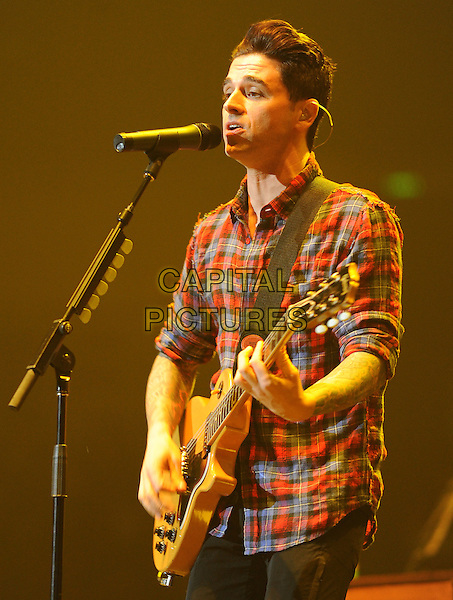 DASHBOARD CONFESSIONAL.perform a sold out show at The Honda Center in Anaheim, California, USA, February 26th 2010                                                                    .music concert on stage gig half length red plaid shirt guitar playing microphone mouth open singing .CAP/RKE/DVS.©DVS/RockinExposures/Capital Pictures