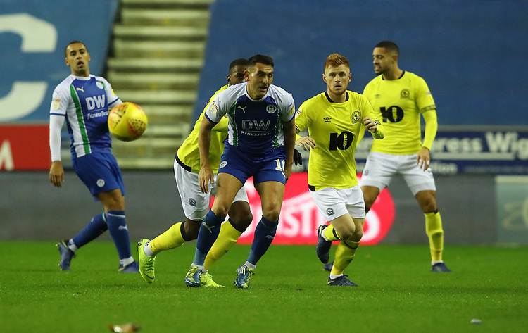 Wigan Athletic's Gary Roberts and Blackburn Rovers' Harrison Reed<br /> <br /> Photographer Rachel Holborn/CameraSport<br /> <br /> The EFL Sky Bet Championship - Wigan Athletic v Blackburn Rovers - Wednesday 28th November 2018 - DW Stadium - Wigan<br /> <br /> World Copyright © 2018 CameraSport. All rights reserved. 43 Linden Ave. Countesthorpe. Leicester. England. LE8 5PG - Tel: +44 (0) 116 277 4147 - admin@camerasport.com - www.camerasport.com