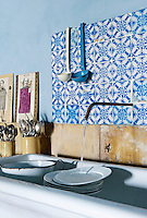 In the kitchen the stone sink is garden salvage, the tap is simply a piece of copper pipe and the splashback is made from 18th century ceramic tiles