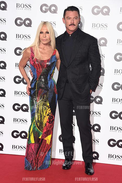 LONDON, UK. September 05, 2018: Donatella Versace & Luke Evans at the GQ Men of the Year Awards 2018 at the Tate Modern, London