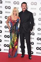 LONDON, UK. September 05, 2018: Donatella Versace & Luke Evans at the GQ Men of the Year Awards 2018 at the Tate Modern, London