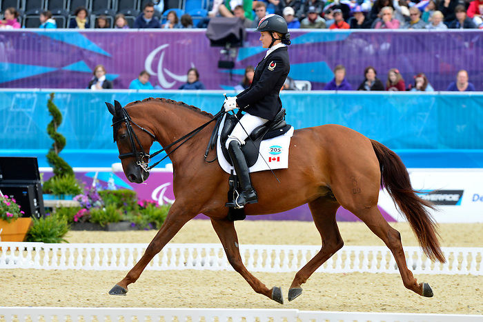 LONDON, ENGLAND 01/09/2012 - Lauren Barwick, riding Off to Paris, in the Dressage Individual Championship Test - Grade II Final at the London 2012 Paralympic Games in Greenwich Park. (Photo: Phillip MacCallum/Canadian Paralympic Committee)