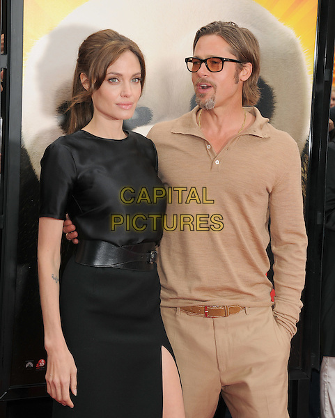 ANGELINA JOLIE & BRAD PITT .at The Dreamworks Animation L.A. Premiere of 'Kung Fu Panda 2' held at The Grauman's Chinese Theatre in Hollywood, California, USA,.May 22nd 2011..half length dress belt couple glasses tinted sunglasses beige brown top shirt black goatee facial hair beard  trousers     dress belt slit split  silk satin arm around skirt                                                                  .CAP/RKE/DVS.©DVS/RockinExposures/Capital Pictures.