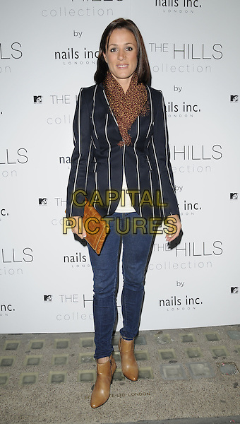 NATALIE PINKHAM.The Hills Collection launch party, Nails Inc. shop, South Molton St., London, England..September 16th, 2009.full length jeans denim brown boots  blue pinstripe jacket scarf clutch bag .CAP/CAN.©Can Nguyen/Capital Pictures.