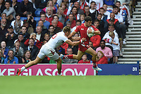 Wales's Luke Morgan evades the tackle of  England's Christian Lewis-Pratt before he scores his sides third try <br /> <br /> Wales Vs England - men's classification 5th - 6th place match<br /> <br /> Photographer Chris Vaughan/CameraSport<br /> <br /> 20th Commonwealth Games - Day 4 - Sunday 27th July 2014 - Rugby Sevens - Ibrox Stadium - Glasgow - UK<br /> <br /> © CameraSport - 43 Linden Ave. Countesthorpe. Leicester. England. LE8 5PG - Tel: +44 (0) 116 277 4147 - admin@camerasport.com - www.camerasport.com