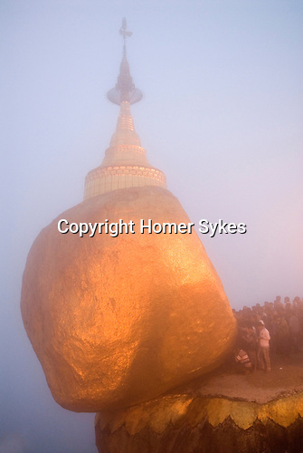 Golden Rock at Kyaiktiyo only male pilgrims are allowed to apply squares of gold leaf to the Golden Rock during the November Full Moon ceremony. Burma Myanmar 2011