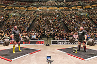 """Thousands of fans watch on as Georgia's Konstantine Janashia (left) takes on England's Eddie """"The Beast"""" Hall during the European Strongest Man competition."""