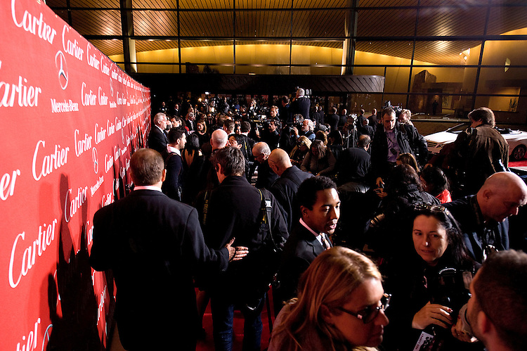Photographers and Film Festival staff crowd in near the conclusion of the red carpet event during the Palm Springs International Film Festival awards show at the Palm Springs Convention Center on Saturday.