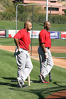 Vernon Wells #10 (left) and Torii Hunter #48 (right) of the Los Angeles Angels participate in batting practice during spring training workouts at the Angels complex on February 22, 2011  in Tempe, Arizona. .Photo by:  Bill Mitchell/Four Seam Images.