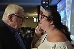 Garden City, New York, USA. November 6, 2018. Nassau County Democrats watch Election Day results at Garden City Hotel, Long Island. NYS Senator JOHN BROOKS, who won re-election to NYS Senate SD8, is talking with LAURA CORCORAN-DOOLIN.