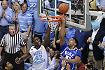 07 March 2015: Duke's Jahlil Okafor (15) uses a reverse layup to beat North Carolina's Joel James (42) who ends up going through the rim in an attempt to block the shot. The University of North Carolina Tar Heels played the Duke University Blue Devils in an NCAA Division I Men's basketball game at the Dean E. Smith Center in Chapel Hill, North Carolina. Duke won the game 84-77.