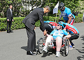 United States President Barack Obama greets members of the Wounded Warrior Project's Soldier Ride on May 4, 2011 on the South Lawn of the White House in Washington, D.C.  Standing next to the President is Marine General James Cartwright and Assistant Secretary of the VA Tammy Duckworth. .Credit: Gary Fabiano / Pool via CNP