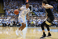 CHAPEL HILL, NC - MARCH 03: Christian Keeling #55 of the University of North Carolina dribbles the ball during a game between Wake Forest and North Carolina at Dean E. Smith Center on March 03, 2020 in Chapel Hill, North Carolina.