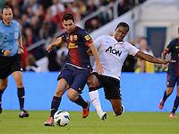FUSSBALL  INTERNATIONAL Testspiel 2012/2013  08.08.2012 Manchester United  - FC Barcelona  Lionel Messi (li, Barca) gegen Antonio Valencia (Manchester United FC)