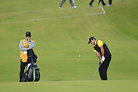Patrick Reed (USA) chips onto the 12th green during Thursday's Round 1 of the 148th Open Championship, Royal Portrush Golf Club, Portrush, County Antrim, Northern Ireland. 18/07/2019.<br /> Picture Eoin Clarke / Golffile.ie<br /> <br /> All photo usage must carry mandatory copyright credit (© Golffile | Eoin Clarke)
