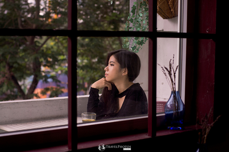 A young lady in a cafe in Saigon, Vietnam.