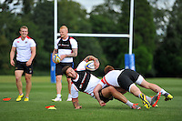 Matt Banahan of Bath Rugby is tackled to ground. Bath Rugby training session on September 4, 2015 at Farleigh House in Bath, England. Photo by: Patrick Khachfe / Onside Images