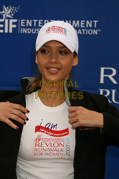 JESSICA ALBA.14th Annual Entertainment Industry Foundation Revlon Run/Walk For Women held at The Los Angeles Memorial Coliseum, Los Angeles, California, USA,.12 May 2007..half length cap hat white hands .CAP/ADM/RE.©Russ Elliot/AdMedia/Capital Pictures.