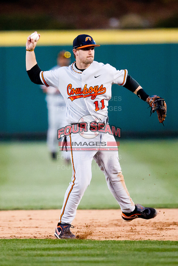 Robbie Rea (11) of the Oklahoma State Cowboys throws to first  base during a game against the Missouri State Bears at Hammons Field on March 6, 2012 in Springfield, Missouri. (David Welker / Four Seam Images)