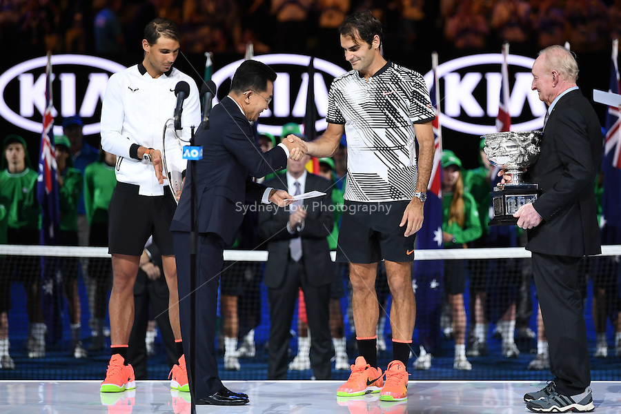 January 29, 2017: Roger Federer of Switzerland accepts his prize after winning the Men's Final against Rafael Nadal of Spain on day 14 of the 2017 Australian Open Grand Slam tennis tournament in Melbourne, Australia. Photo Sydney Low