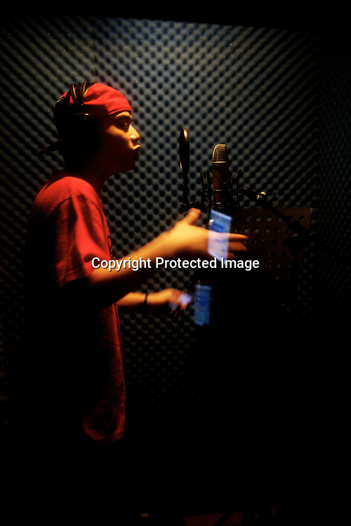 21 year old rapper, Troy Nery aka Sincity sings rap for his album at the recording studio in Intramuros, the oldest district of the present day city of Manila, Philippines. Photo: Sanjit Das