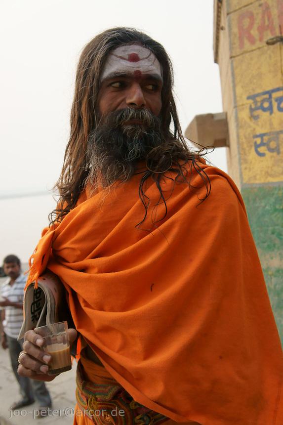 Sadhu drinking Masala tea at river Ganga in Varanasi, India