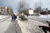Rick Casillo and team run past spectators on the bike/ski trail with an Iditarider in the basket during the Anchorage, Alaska ceremonial start on Saturday, March 5, 2016 Iditarod Race. Photo by O'Hara Shipe/SchultzPhoto.com
